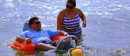 Mario in water in Mobi-Chair and his wife