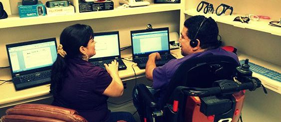 Woman and Man in Wheelchair in tech lab
