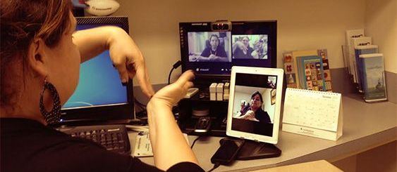 Deaf Staff Member signing to another using Facetime on iPad